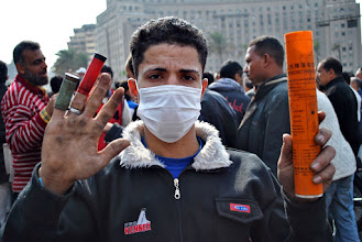 Photo: A youth shows off the assortment of weapons used on protesters over the course of the past several days of clashes in Tahrir Square.