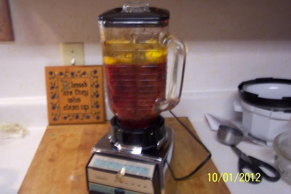 Take plums out of refrigerator,  add oil and three eggs. Blend well, in the blender.