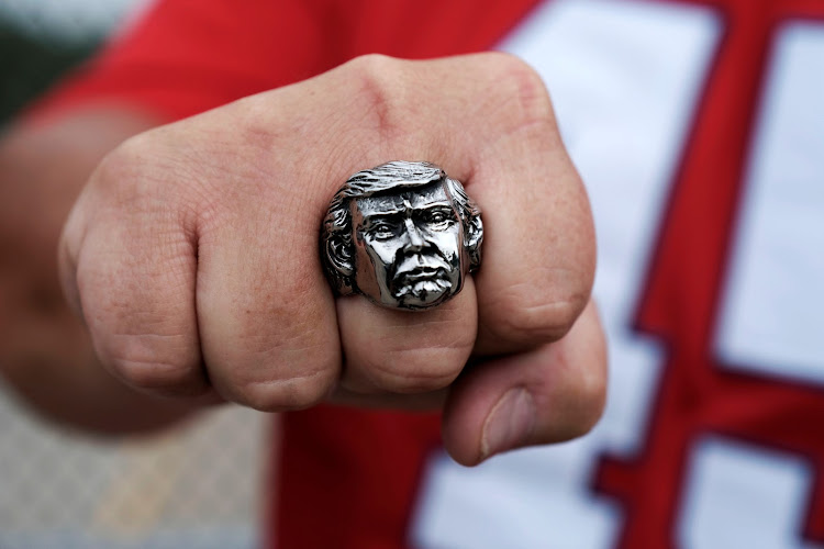 A supporter shows off a ring with the face of US President Donald Trump in Cincinnati, Ohio.
