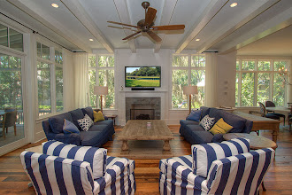 Photo: Living Room with mounted flat screen TV, beamed ceiling, hardwood floors and direct access to screened porch.