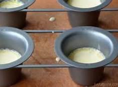 In a mixer bowl, combine eggs, milk;bet well. Add flour, salt and spice. Beat...