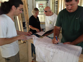Photo: September 19, 2012. Reviewing kitchen outlet placement, everyone's taking notes. Photo by Lake Weir Living
