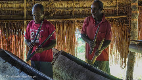 Papua. New Guinea East Sepik River Clans Crocodile Traditions. Drumming in the men's house