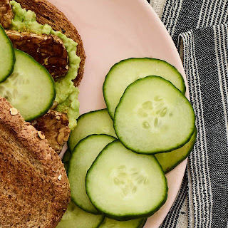 Marinated Tempeh and Cucumber Sandwich With Avocado Spread.