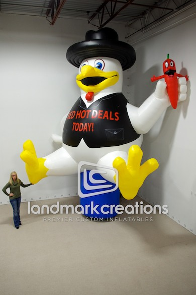 "Photo: With his black vest, bolero hat and jalapeno pepper sidekick, ""Cluck Western"" chicken ads zest to Clayton Homes' ""Red Hot Deals"" promotions."