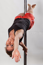 Photo: Vertical Pole Gymnastics - Upside Down One Handed Lock Layout