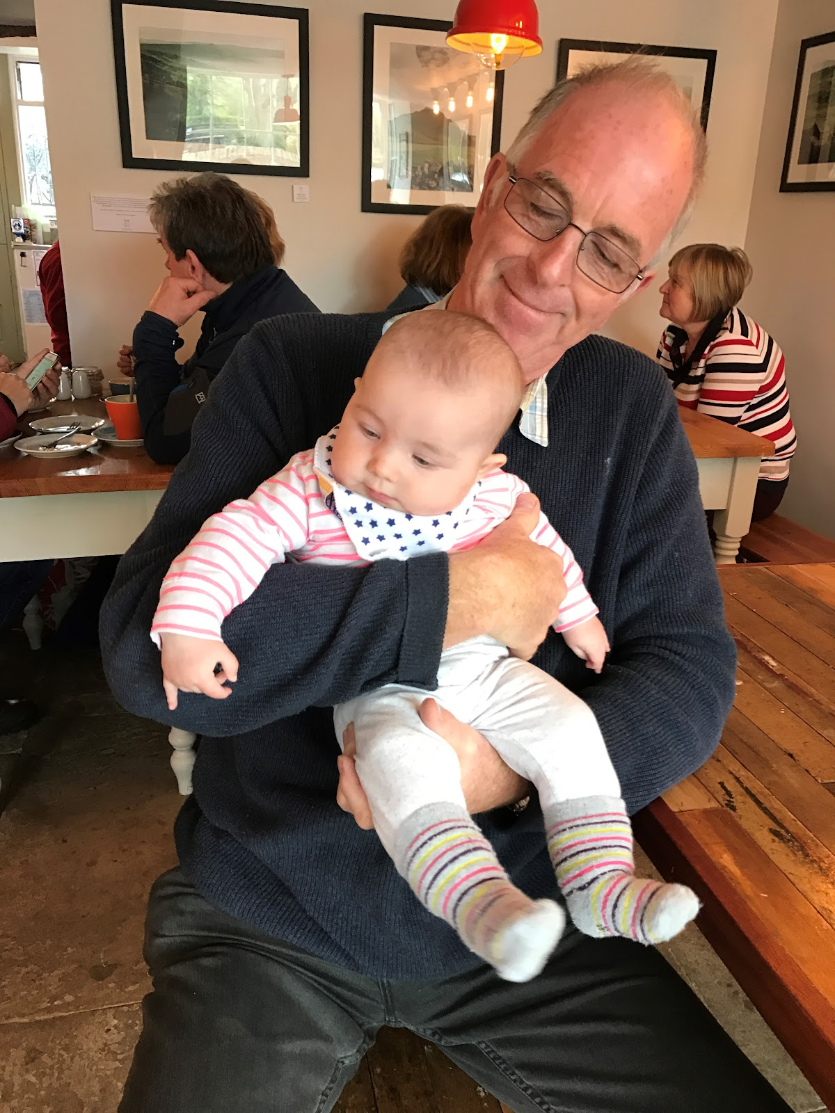 Grandad holding his grandaughter