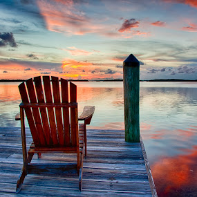Sunset Chair by Tim Azar - Landscapes Sunsets & Sunrises ( reflection, tim azar, florida keys, ocean, yellow, landscape, dock, sky, florida, pier, cloudy, pink, islamorada fish company, clouds, water, islamorada, orange, hdr, nik dfine, sunlight, hdr efex pro 2, pwcredscapes, chair, blue, sunset, 3 exposures )