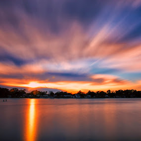 Windy Sunset by James Gramm - Landscapes Cloud Formations ( clouds, water, sky, sunset, trees, reflections, long exposure )