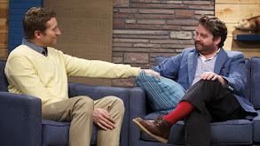 Zach Galifianakis Wears a Blue Jacket & Red Socks thumbnail