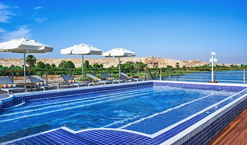 Enjoy the pool (still a rarity on a river ship) during your voyage on the Nile River aboard Oberoi Philae.