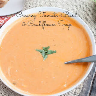 Creamy Tomato-Basil & Cauliflower Soup {with Spooky Sour Cream Spiderwebs!}.