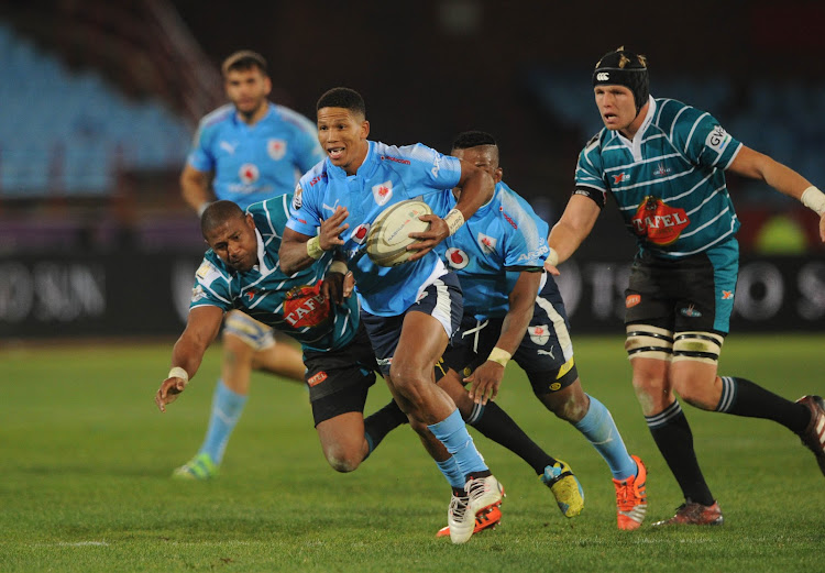 Manie Libbok of Blue Bulls evades a tackle from Jonathan Francke of Griquas during the Currie Cup rugby match on the 01 September 2017 at Loftus Versfeld Stadium.