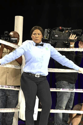 Female boxing referee Pumeza Zinakile in action.