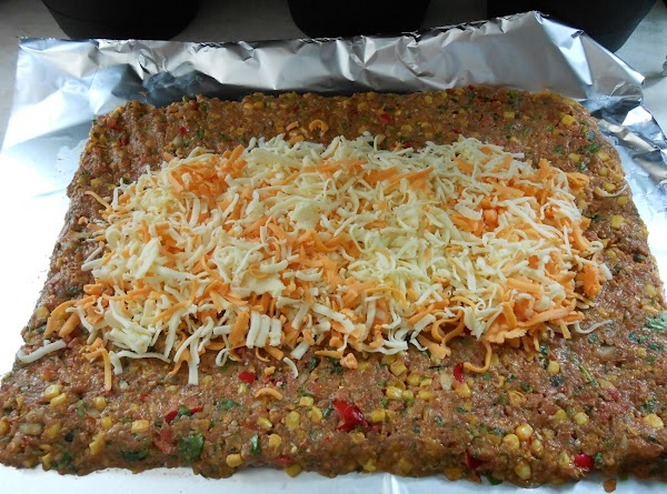 On foil, pat out meat into rectangular shape, about 1 1/2 thick.  ...