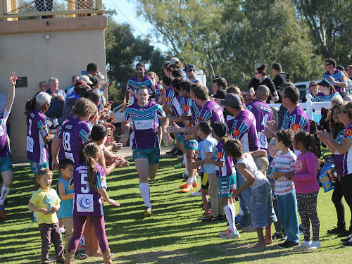 Narrabri captain-coach Lachlan Cameron leads his side onto the park at Collins Park on Sunday. The side was cheered onto the field by club players and fans proudly wearing their purple jerseys.