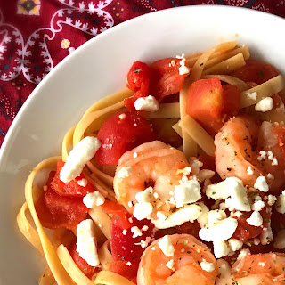Shrimp with Tomatoes and Goat Cheese over pasta.