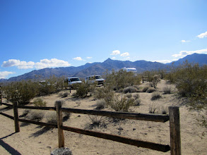 Photo: The parking lot was somewhat full, which is unusual. Three school district vans were parked and the kids were coming back from the dunes as we entered the trail.