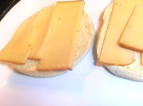 toast rolls in oven until golden brown. add 1 oz of cheese on bottom...
