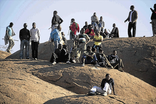 Striking Lonmin workers meeting on a hilltop near the Marikana informal settlement in North West at the height of the Lonmin strike. File photo.