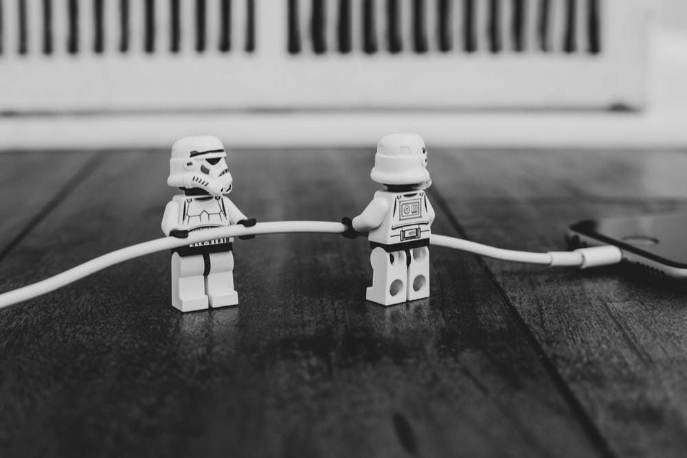 grayscale photography of two Lego minifigs