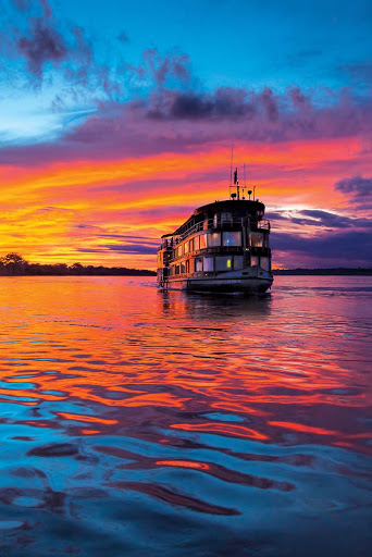 Delfin-II-at-sunset.jpg - At sunset, Delfin II sails down the Marañon River, the principal source of the Amazon River.