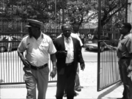 SHOOTING DISASTER: Chief traffic officer Judas Chiloane and Bushbuckridge mayor Milton Morema arrive at the Mhlala police station shortly after the shooting that left two top cops dead yesterday morning.  02/12/2008. Pic. Riot Hlatshwayo.  © Sowetan