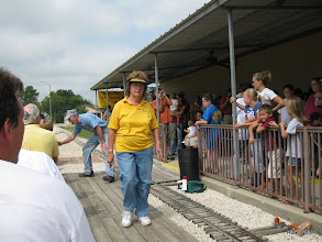 Photo: Virginia Freitag, the Station Master, has her eyes glued on the next train.      HALS 2009-0919