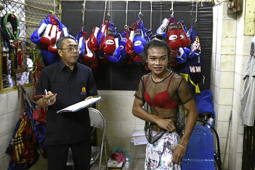 TOUGH COOKIE Muay Thai boxer Nong Rose Baan Charoensuk, 21, who is transgender, prepares to be weighed before her match at the Rajadamnern Stadium in Bangkok earlier this month.