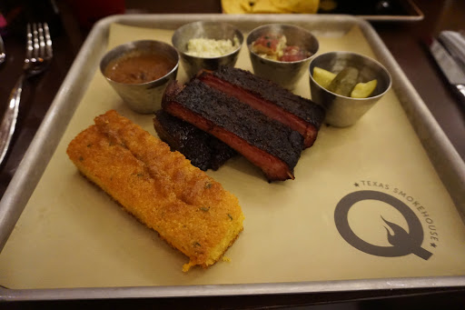 Q_Ribs.JPG - Speaking of food, the new Q Texas Smokehouse serves up authentic Southern barbecue nightly and also hosts live music for those late-night country music fans.