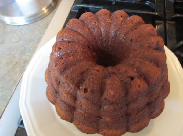 If you want to show details of cake from the pans dust lightly with...