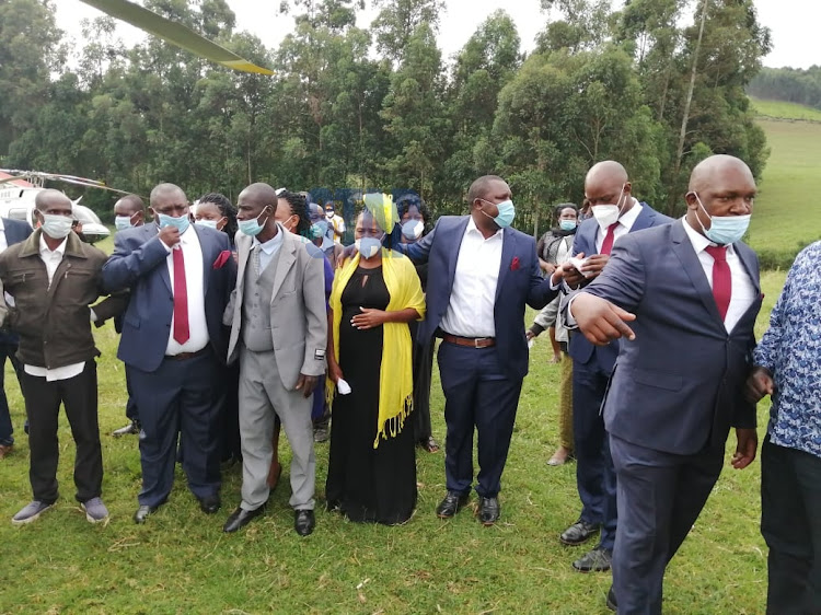 Mourners and family members when they received the body of Nyamira Governor John Nyagarama at Riamanoti Primary School on December 24, 2020.