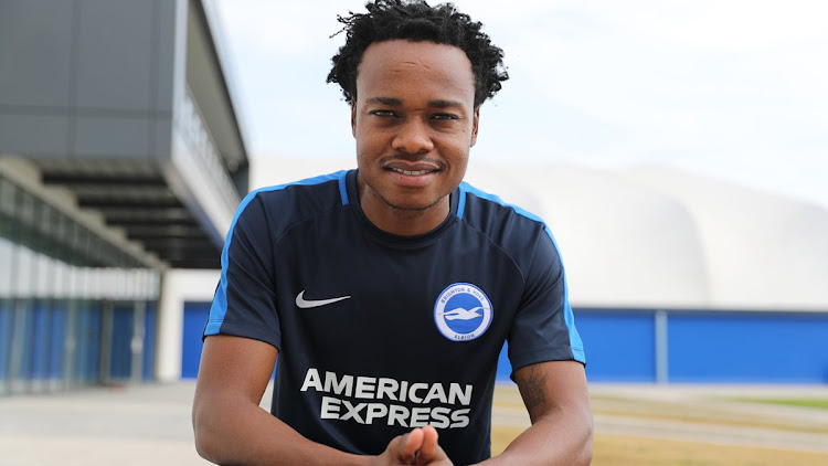 Brighton and Hove Albion have completed the signing of striker Percy Tau from Sundowns.