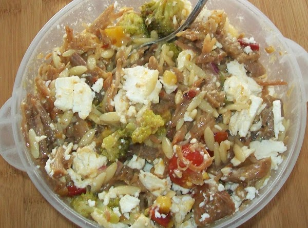Then crumble the Feta cheese into the orzo and pork and thoroughly mix again....