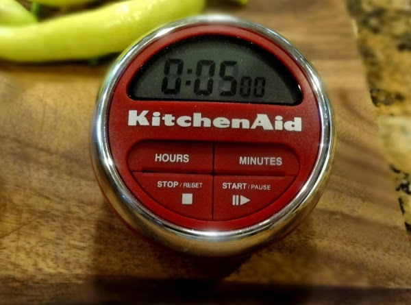 Place the prepared peppers in the boiling water and set the timer for 5...