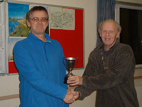 Photo: Gareth Williams receiving the 2011/2012 Wiltshire Chess Championship Minor trophy from Tony Ransom, Langley Burrell Village Hall, 5th November 2012.