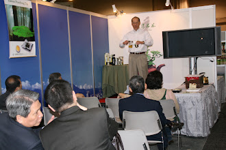 Photo: Larry demonstrating the Piao I teapot and other Piao I products.