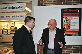 """Photo: BCCC professor and author, Bill Pezza discusses his latest book, """"Homegrown"""" with an attendee."""