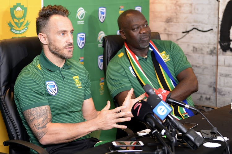 SA national cricket team captain Faf du Plessis (L) and head coach Ottis Gibson addresses the media during a departure press conference at Powerade Centre of Excellence in Pretoria on May 18, 2019.