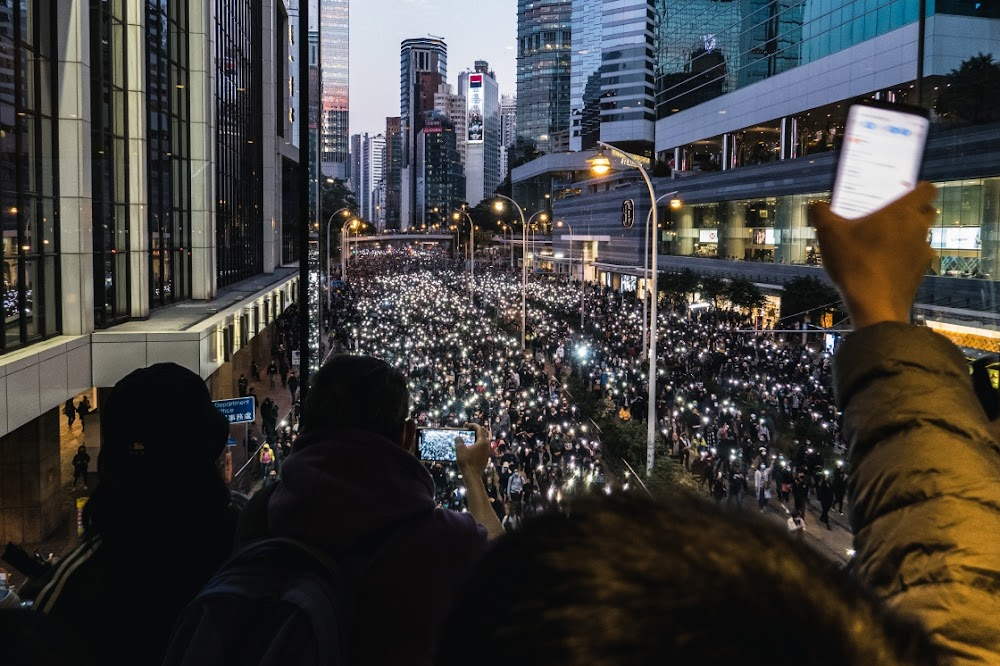 Defiant Hong Kong protesters hold biggest rally in six months