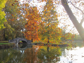 Photo: Stone bridge reflected in a pond on a beautiful autumn day at Eastwood Park in Dayton, Ohio.