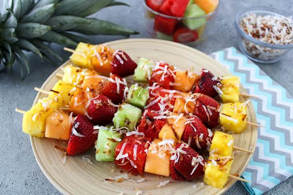 Toasted Coconut Grilled Fruit Skewers On A Plate.