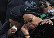 Graça Machel and Winnie Mandela at at the funeral of former President Nelson Mandela at Mthatha Airport.: