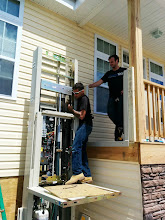 Photo: Here's a couple of our guys working on a V-1504 hydraulic wheelchair lift in Brigantine, NJ. Battling the heat to get the job done. Good work!