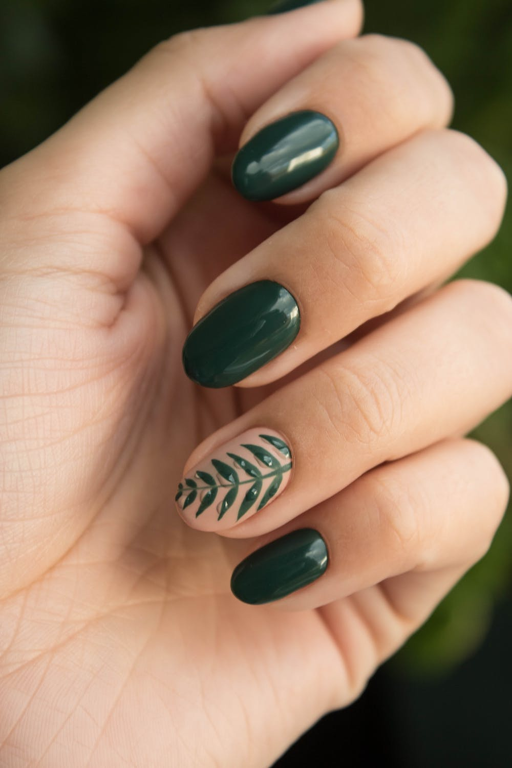 hand with green nail art
