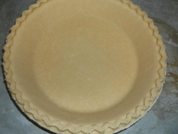Place pie/pastry crust on rimmed baking sheet. Place oven rack in middle position in...