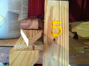 Photo: Brosig campsite yellow number wood signs