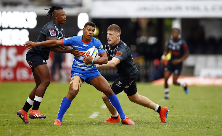 DHL Stormers fullback Damian Willemse is tackled by SÕbusiso Nkosi and Jacques Vermeulen of the Cell C Sharks during their Super Rugby match at Jonsson Kings Park on Saturday.