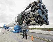 Billionaire South African Elon Musk, pictured with one of his rockets. File photo.