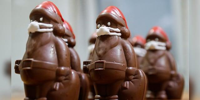 Hungarian confectioner Laszlo Rimoczi says customers love his chocolate Santas and their marzipan masks.